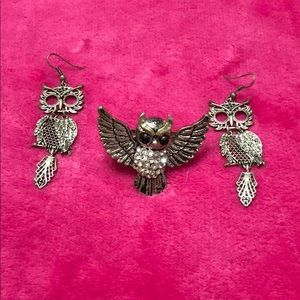Silver owl earrings and an owl ring
